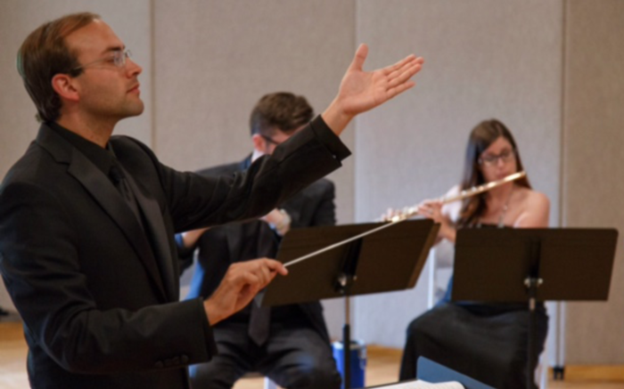 conductor performing conducting etudes