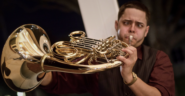 Juan Berrios of Dallas Brass playing French horn